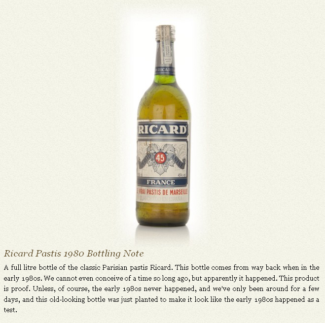 Bottle of Ricard Pastis with marketing text